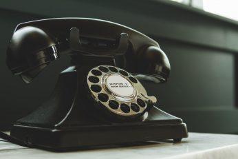 Black Rotary Telephone On White Table