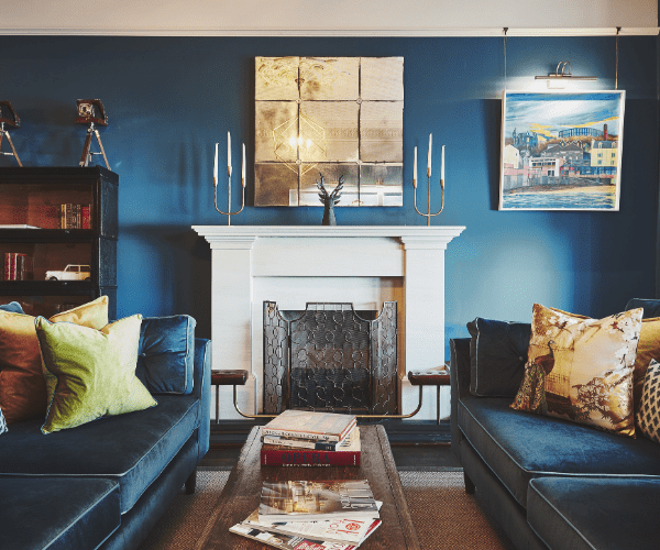 Honesty Bar Lounge With Blue Velvet Couches